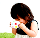 toddler sips from drinking cup